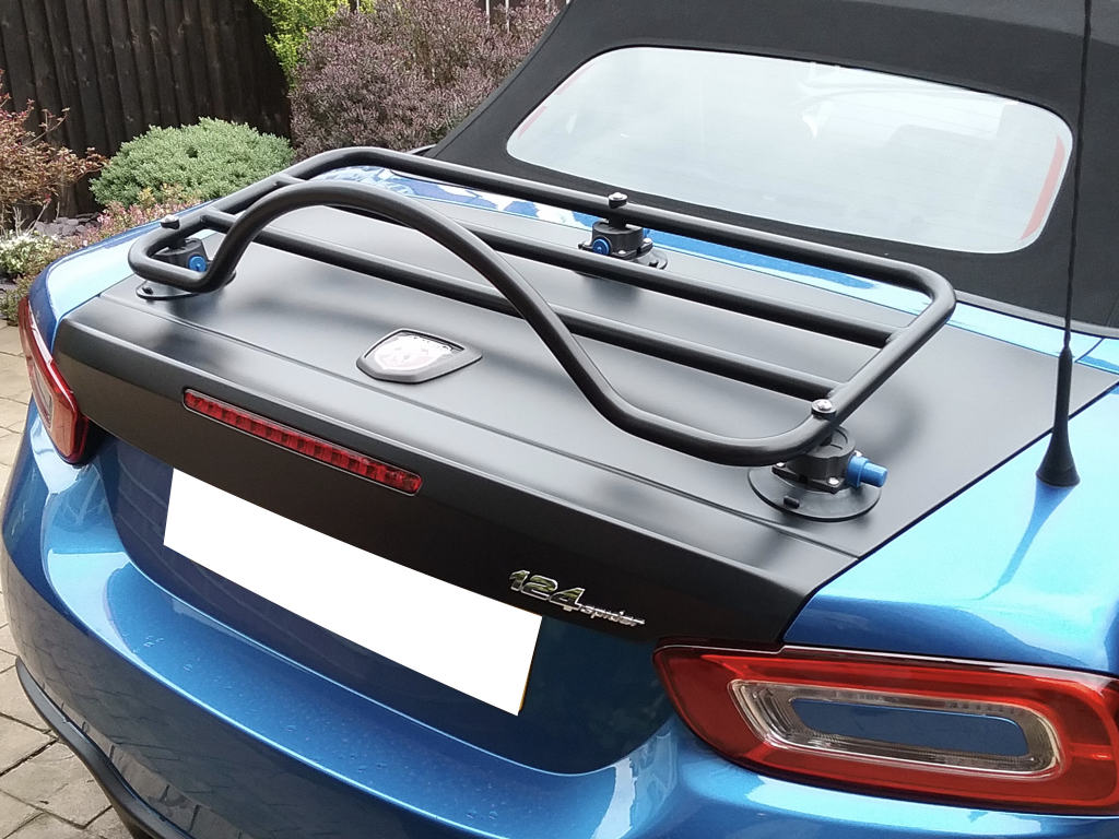 revo rack luggage rack for fiat 124 abarth spider fitted to a blue fiat 124 spider