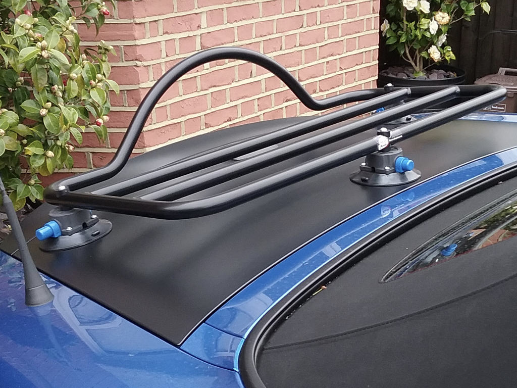 124 spider abarth luggage rack in black fitted to a blue fiat 124