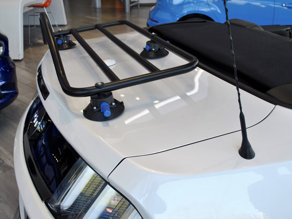 side view of revo rack luggage rack on a white ford mustang
