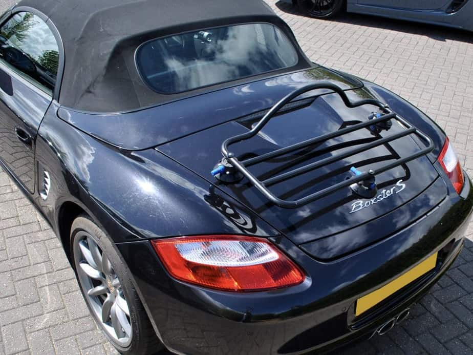 black porsche boxster 987 with a luggage rack fitted photographed from above