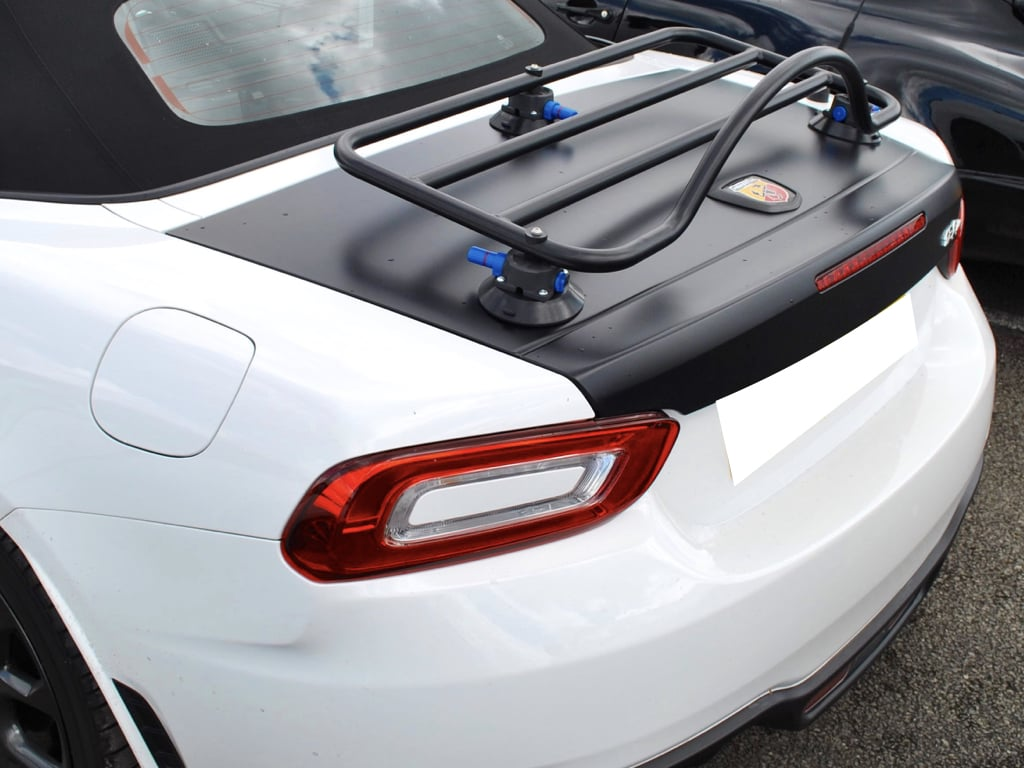 revo-rack luggage rack in black fitted to a white fiat 124 abarth spider