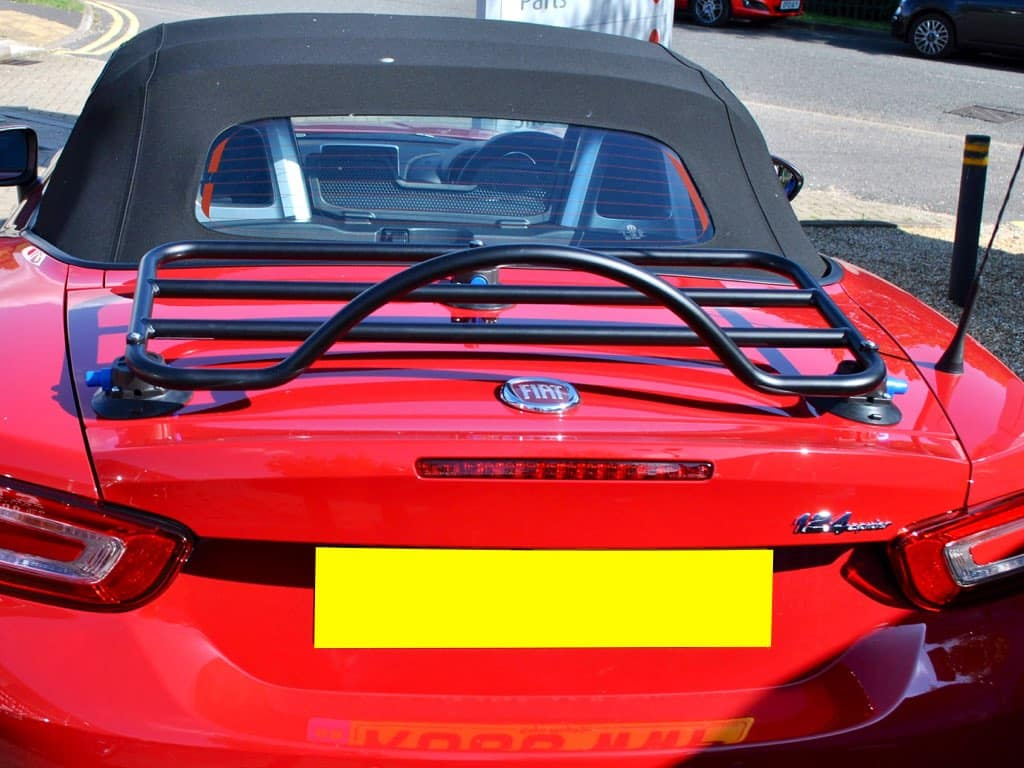 revo-rack black convertible luggage rack fitted to a red fiat 124 spider