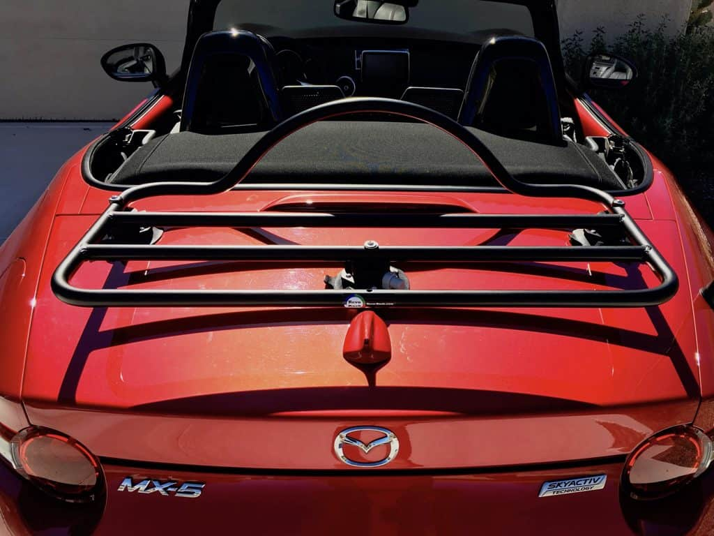 mazda miata nd trunk rack in black fitted to a red miata in the sunshine