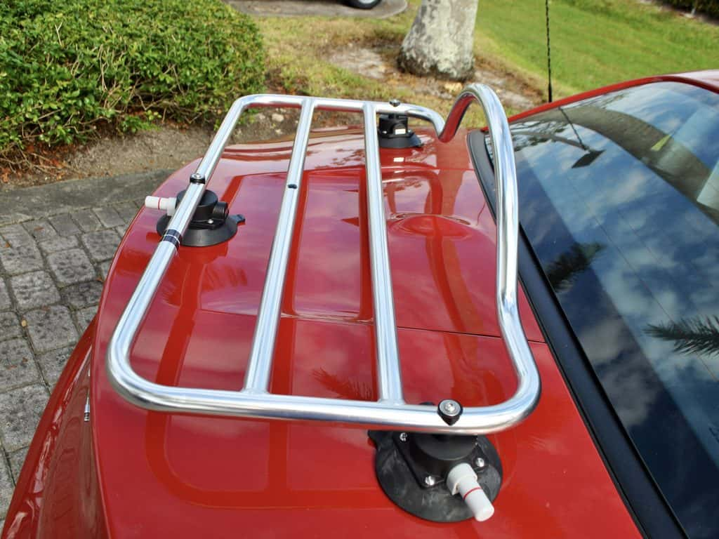 bmw z4 chrome luggage rack on the deck lid of a red bmw z4 e89