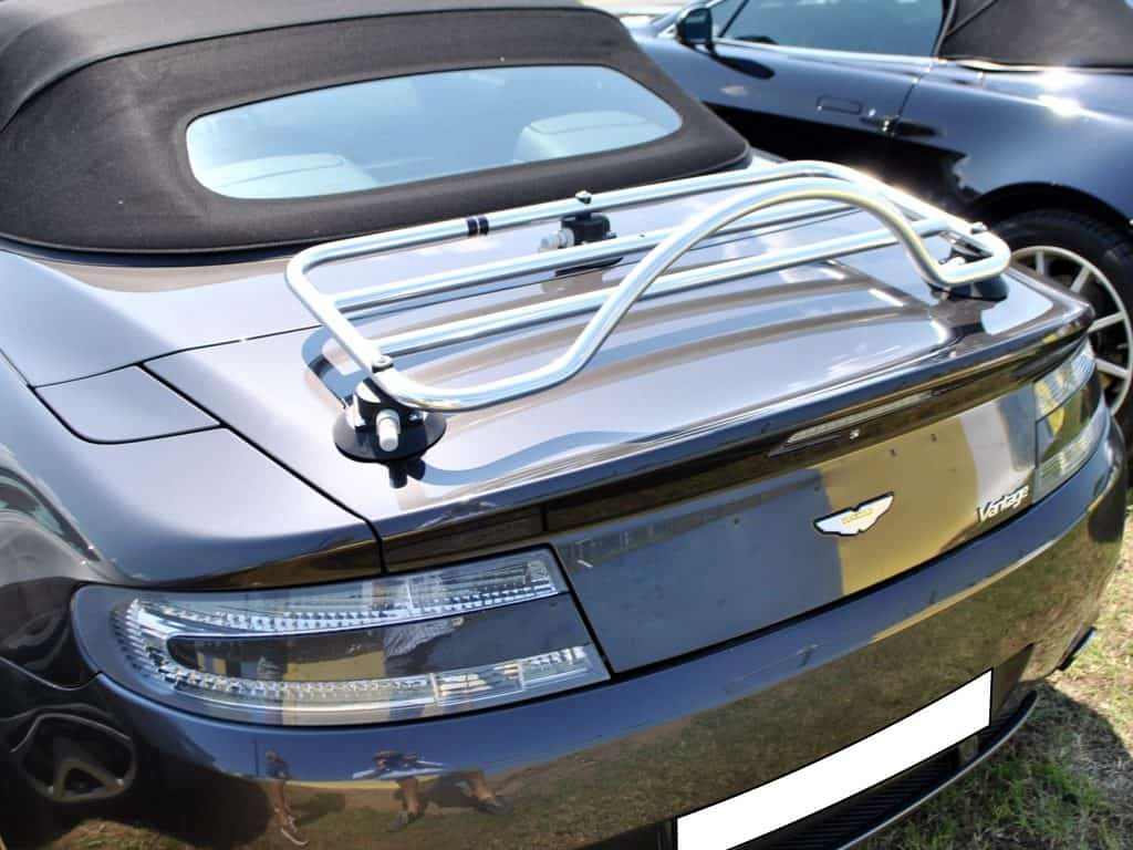 dark grey aston martin vantage v8 convertible with a revo-rack pa luggage rack fitted photographed from the right rear