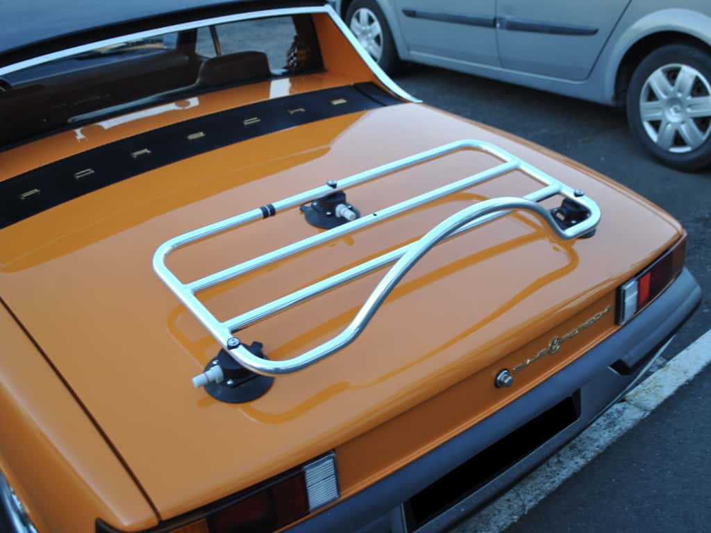 orange 914 porsche with a luggage rack fitted photographed from the rear