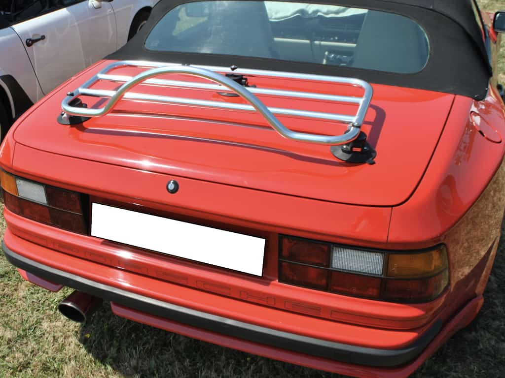 red porsche 944 cabriolet photographed from the rear with a luggage rack fitted