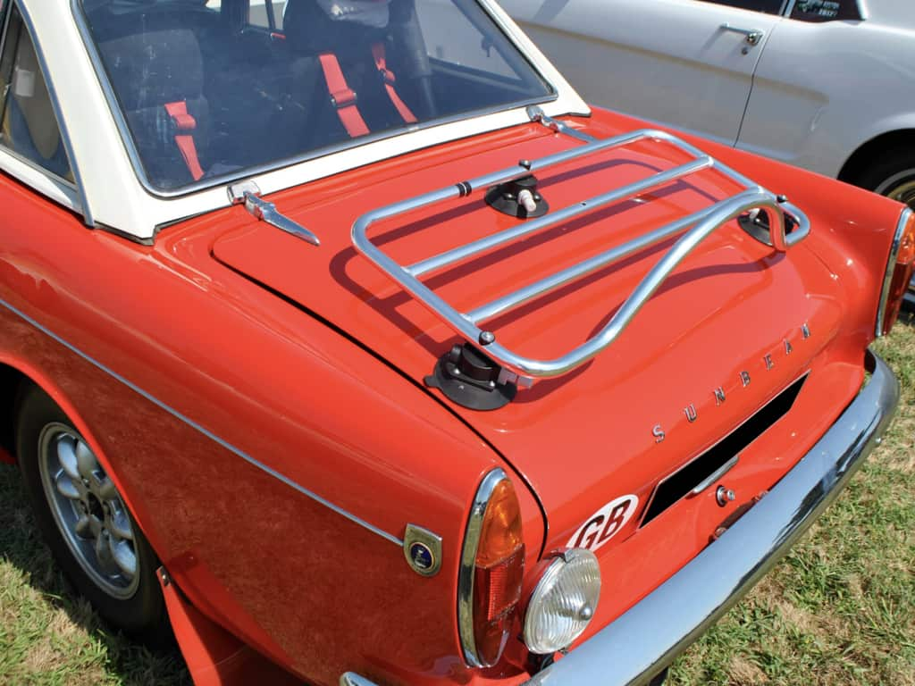 red sunbeam alpine with a stainless steel luggage rack fitted