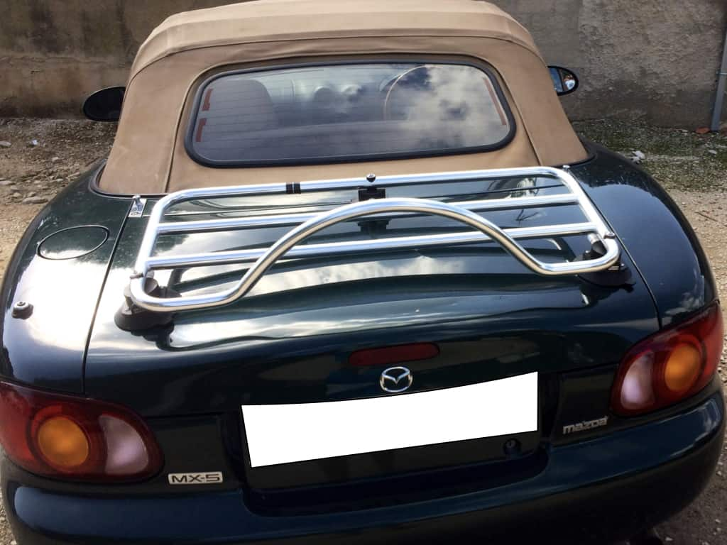 revo rack stainless steel luggage rack fitted to a green mk2 mx5 with a cream hood