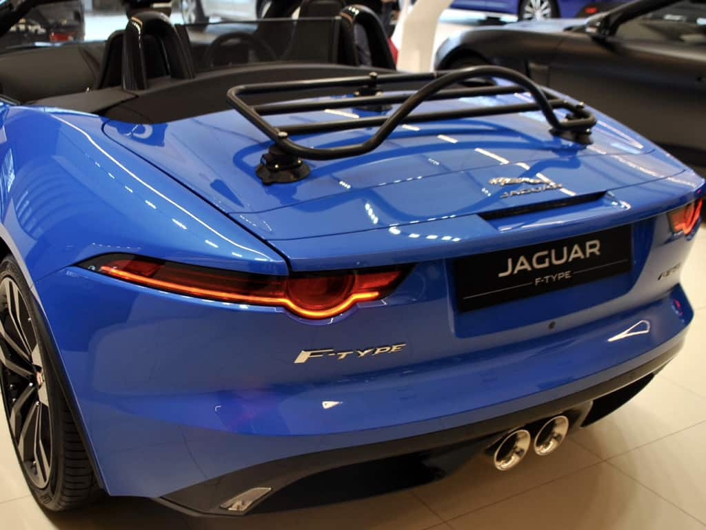 black luggage rack fitted to a blue F Type convertible Jaguar