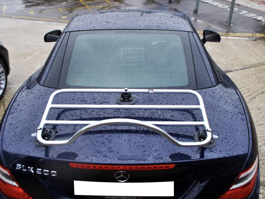 dark blue mercedes benz slk in the rain with a revo rack pa luggage rack fitted photographed from above