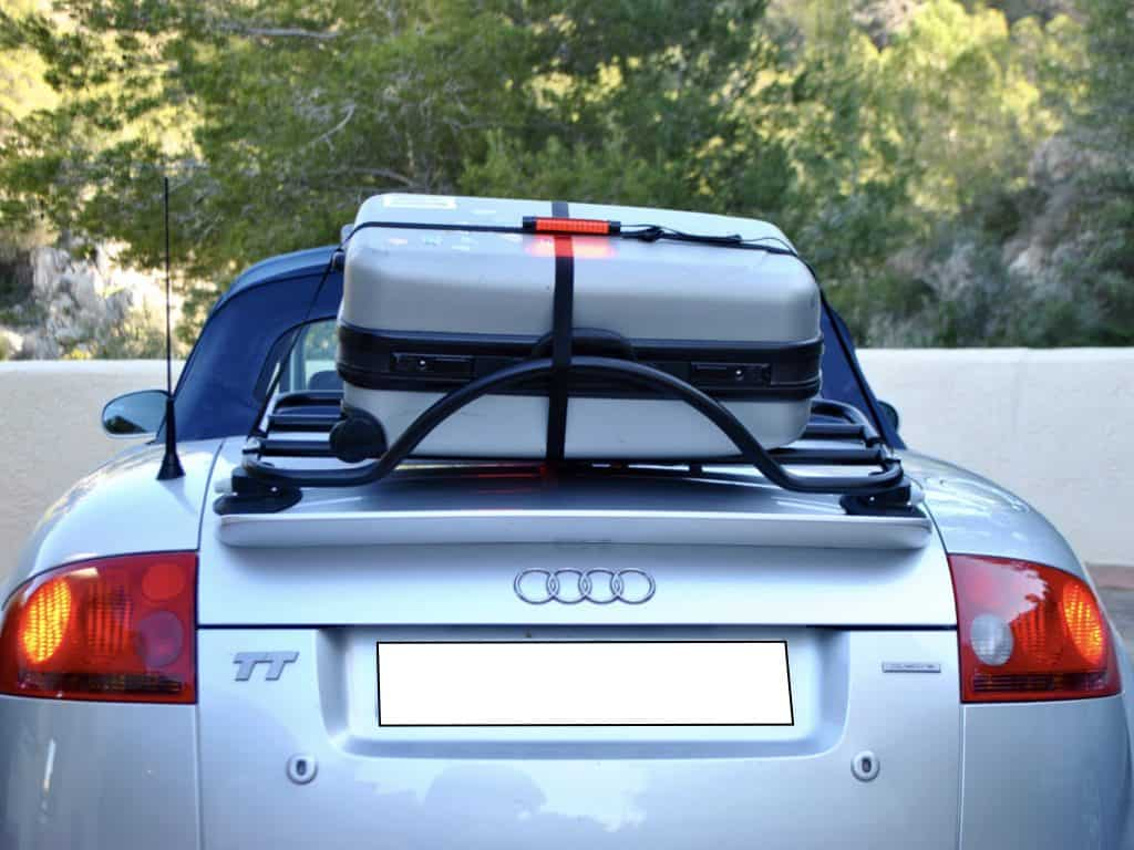 convertible in silver with revo-rack luggage rack with silver suitcase on it and third brake light