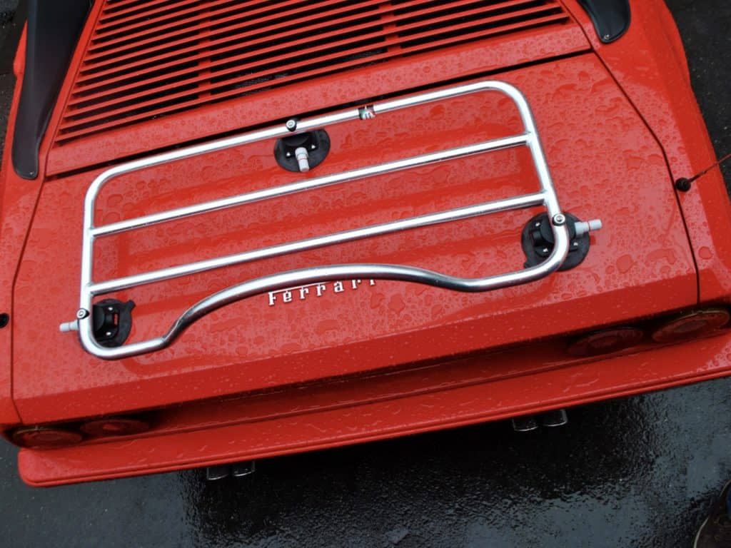 stainless steel luggage rack on red ferrari convertible