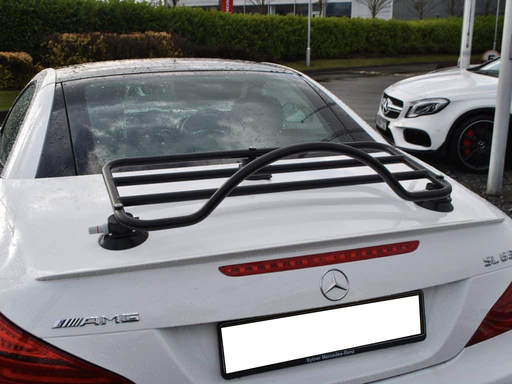black luggage rack on white mercedes-benz cabrio