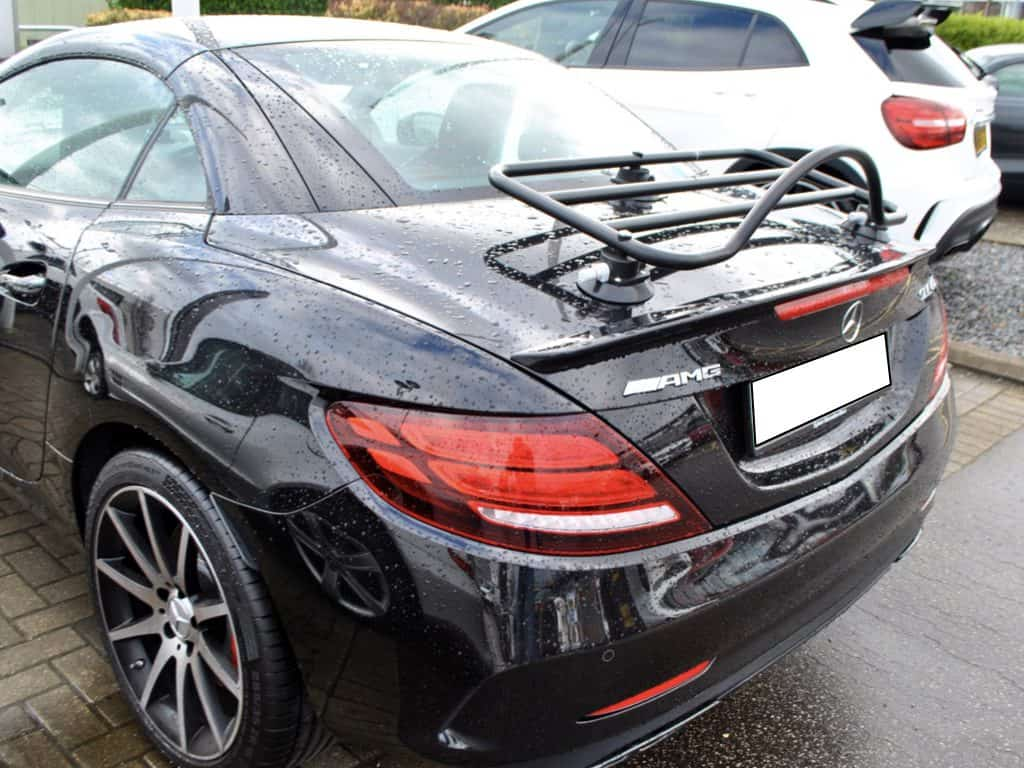 black luggage rack fitted to a black mercedes slc