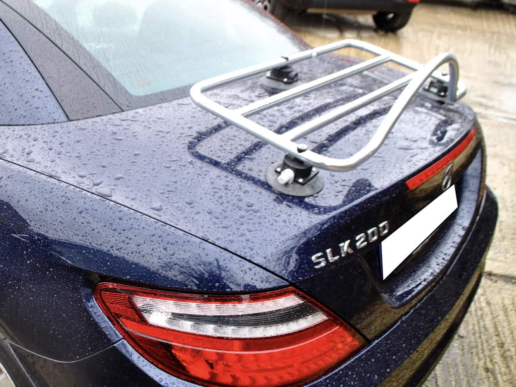 dark blue mercedes slk 200 r172 in the rain with a revo-rack stainless steel boot rack attached