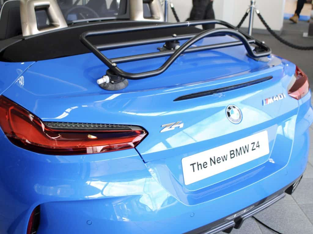 side view of the revo-rack luggage rack on a bright blue bmw g29 z4 in a bmw showroom