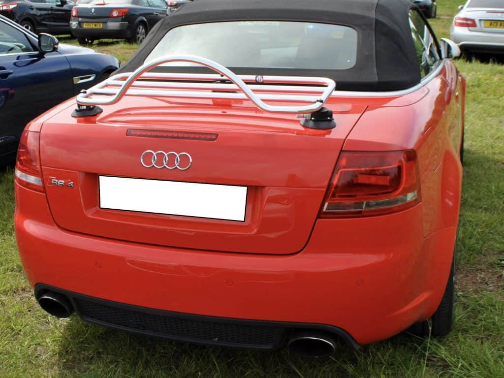 red audi a4 cabriolet with a revo rack luggage rack fitted to the boot/trunk