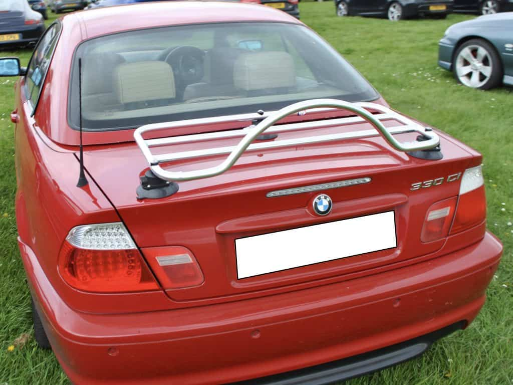 red bmw e46 3 series convertible with a revo-rack luggage rack fitted to the boot
