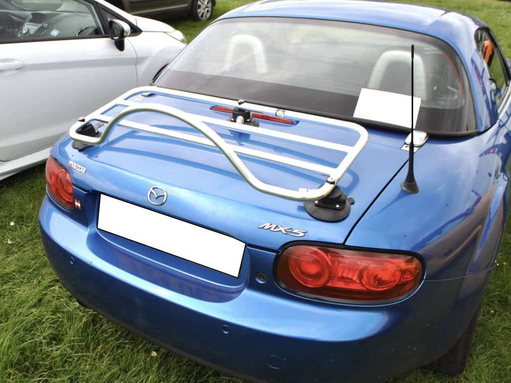 bright blue miata nc phrt with a luggage rack fitted to it