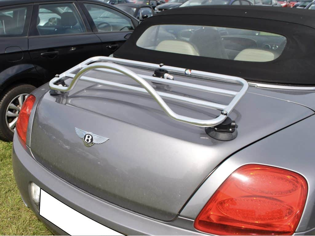 bentley continental convertible in silver with a luggage rack fitted