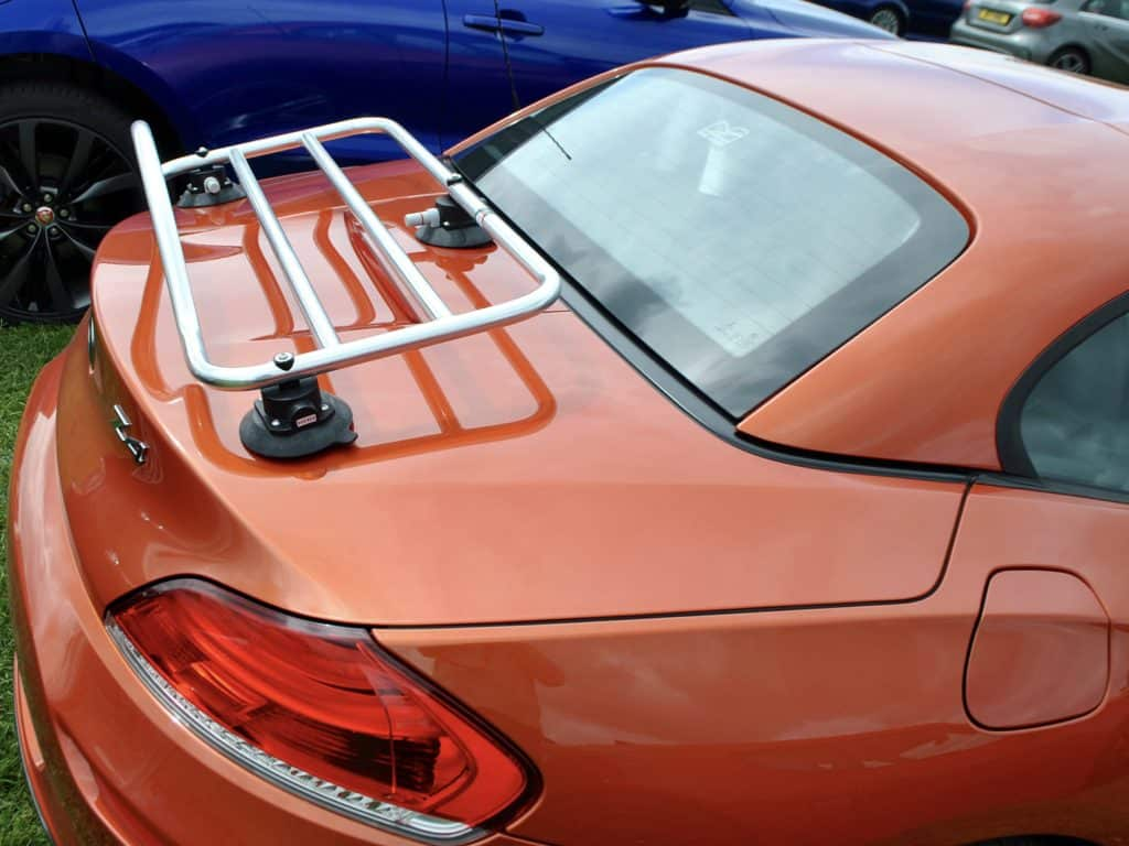 orange bmw z4 e89 with a stainless steel luggage rack fitted photographed from the side