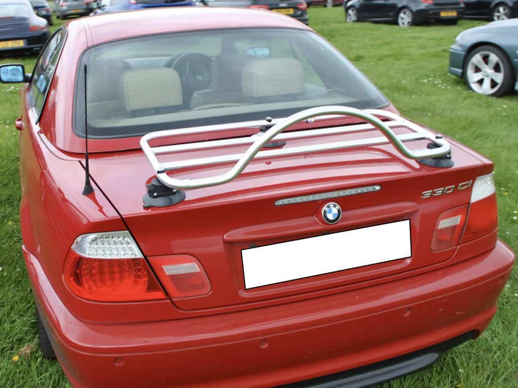 red bmw e46 3 series convertible with a chrome luggage rack fitted